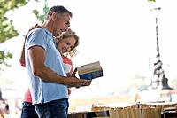 A middle_aged couple looking at books at a book stall