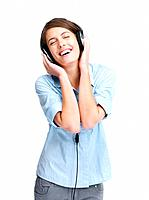 Portrait of a charming young woman enjoying music on headphones over white background