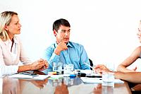 Confident businessman working with his business colleagues on project _ Staff meeting