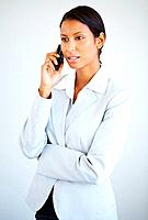 Business woman listening to mobile phone against white background