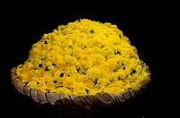basket full of yellow flowers at a local flower market