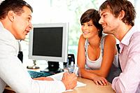Consultant showing new investment plans to young couple