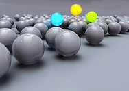 Glowing colorful balls among grey balls