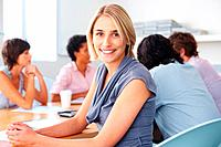 Happy blond smiling with team discussing in meeting
