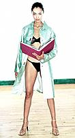 Young Woman in Underwear and Raincoat