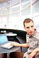 Young man sitting at laptop