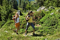 two young women mountain hiking in summer, Austria, Tyrol, Jerzens