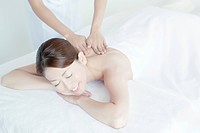 Young Woman Receiving Massaging
