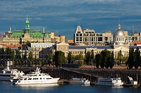 View across St. Lawrence to Old Montreal, city hall in background, Montreal, Quebec, Canada.