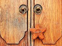 Closed Wood Doors with Leather Private Sign