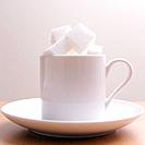 White coffee cup with sugar cubes