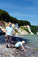 to boys under the chalk cliff in Jasmund National Park, Germany, Mecklenburg_Western Pomerania, Jasmund National Park, Ruegen