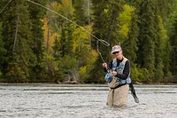 Female fly_fisherman fishing for trout on the Chilko River, Chilcotin Region, British Columbia, Canada.