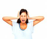Woman holding head and screaming against white background