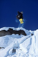 Man snowboarding, Lake Louise, Alberta, Canada.