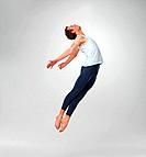 Full length of a male ballet dancer flying against white background _ copyspace