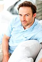 Portrait of a relaxed young man relaxing on sofa _ Indoor