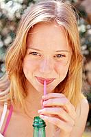 Young Woman Drinking From Straw