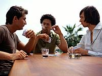 Three Young Men Playing Cards