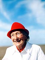 Senior Woman Wearing Red Hat at Beach