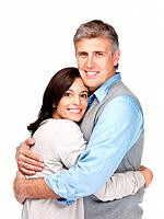 Portrait of a happy senior couple hugging each other against white background