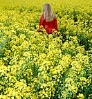 Blond Teenage Girl in Field of Yellow Flowers