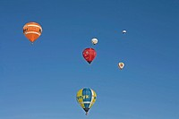 four hot_air balloons flying in front of a blue sky, Germany, Bavaria, Allgaeu, Oberstdorf