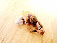 Tattooed Senior Woman Practicing Yoga