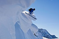 A young male skier catching air off a cornice, Healy Pass, Sunshine Village Backcountry, Banff National Park, Alberta, Canada