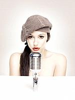 Sexy woman singing in retro mic