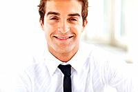 Closeup portrait of successful young male business executive smiling