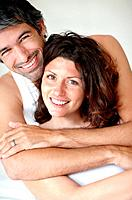 Portrait of mature man embraces woman from back smiling