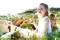 Mother and Daughter Having Picnic in Meadow