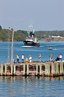 People fishing for Mackerel while fishing boat leaves Blacks Harbour, Bay of Fundy, New Brunswick, Canada