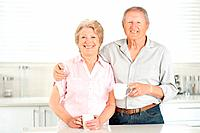 Portrait of a sweet senior couple drinking coffee in the kitchen at home