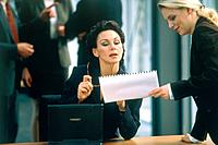 Two businesswomen discussing appointment at a meeting
