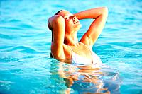 Portrait of sexy young woman enjoying in water