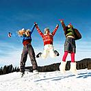 Three Young Women Jumping Having Fun in Snow
