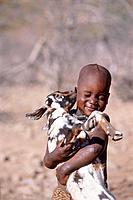 Africa, Namibia, Himba boy holding goat