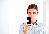 Portrait of beautiful business woman reading text message on white background _ copyspace