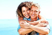 Portrait of smiling young woman and man having great time together on vacation