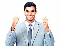Portrait of happy Asian business man giving thumbs up over white background