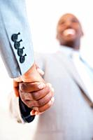 Closeup of African American male executive shaking hands
