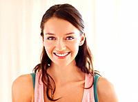 Closeup of trendy young woman smiling