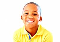 Portrait of young African American boy smiling over white background