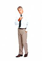 Full length of elegant business man looking at you over white background