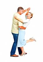 Full length of mature couple enjoying dance over white background