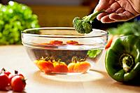 tomatoes, broccoli and vegetables on kitchen table
