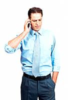 Portrait of a serious businessman talking on mobile phone over white background