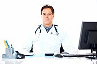 Portrait of a confident mature doctor sitting at his office desk